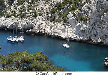 luminy yachts - yachts moored in the crystal clear waters of...