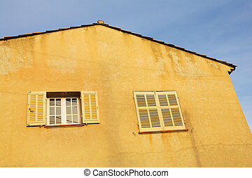 Antibes #133 - Building with two windows in Antibes, France....