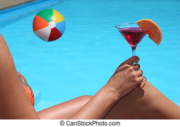 Pool View - Woman drinking by a swimming pool