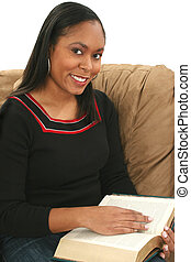 Woman Reading - Beautiful African American woman reading a...