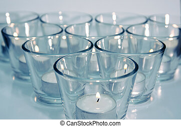 Tea candles on isolated background
