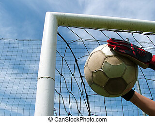 Football - soccer ball in goal - goalkeeper,hands, gloves,...