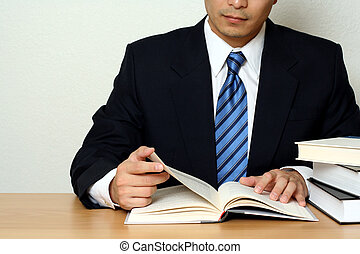 Busy businessman - Businessman reading a book
