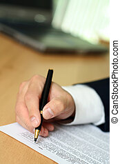 Working businessman - Businessman filing out a form