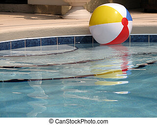 Beach Ball in the Pool - Shot of a beach ball in the pool