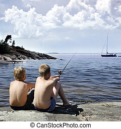 Two boys fishing, sweden