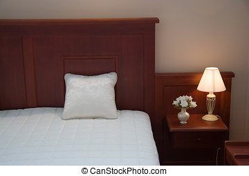 Bedroom. Dormitory. Sleeping room. Bed, pillow and lamp....