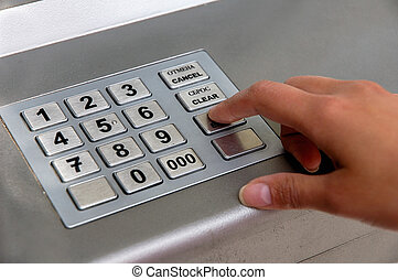 ATM dial - Hand entering personal identification number on...