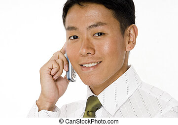 Young Businessman - A handsome young businessman talking on...