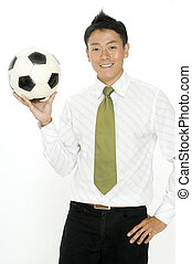 Business and Soccer - A young businessman takes his football...