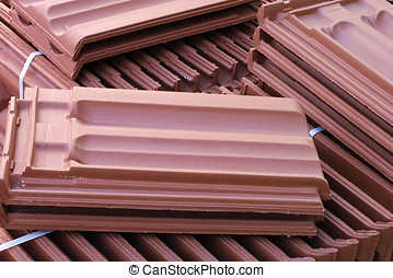 Roofing tiles - Stack of roofing tiles on the agriculture...