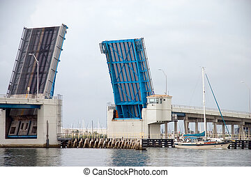 Drawbridge - Open drawbridge allowing sailboat to pass