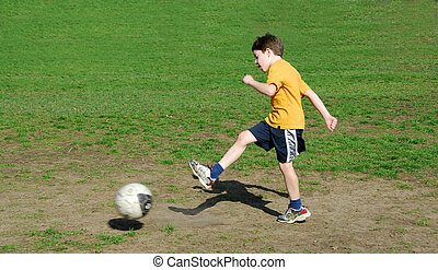 Boy soccer ball - Young boy kicking soccer ball
