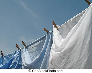 washing line - blue and white pillow cases on washing line...