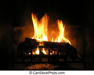 Burning Logs - Flaming logs burning in fire place