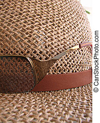 Straw Hat - Macro shot of a straw hat with sunglasses.