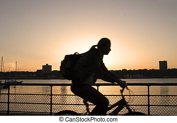 Biking on sunset - Biking along the river