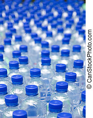 Bottles - Water bottles with blue cups, shallow DOF