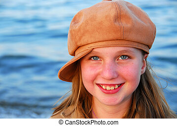 Smiling girl in a hat - Cute preteen girl smiling wearing...