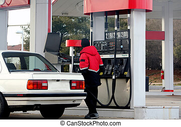 At The Pump - Attendant pumping gas at a gas station.