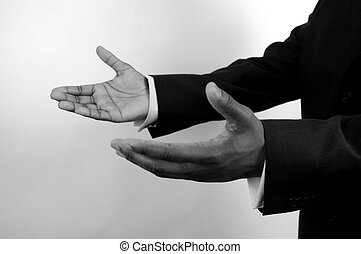 Business-I am here - This is an image of a pair of hand...