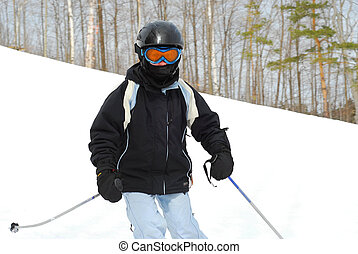 Girl skiing downhill - Young girl skiing downhill
