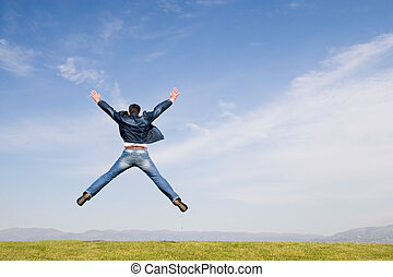 Freedom #3 - Man jumping on green field
