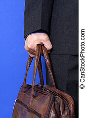 Going to work - A businessman carrying a bag going to work