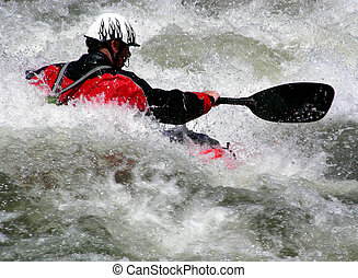 Big Foam - Kayaker attacks the rapids on a mountain river