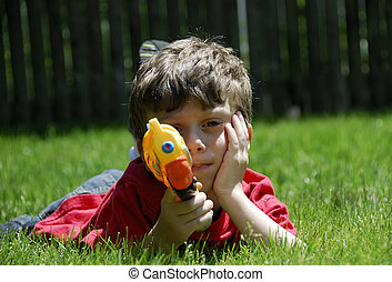 Childs Play - Young Boy With A Water Gun
