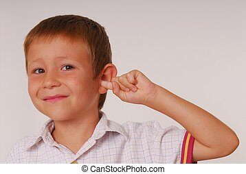 Expressive kid 12 - Young boy with finger in ear