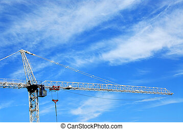 Construction crane - Tall construction crane on background...