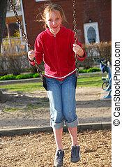 Girl child swings