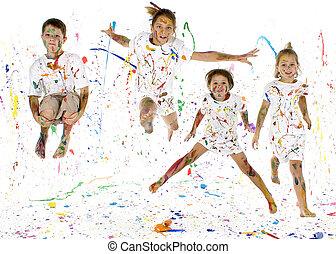 Happy Kids - Children jumping in paint splattered studio