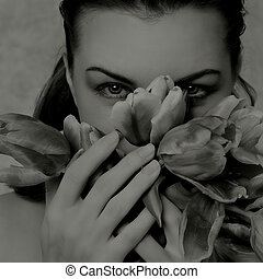 infrared - grey female portrait with tulips