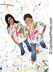 Teen Artist - Two beautiful teen girls covered in paint