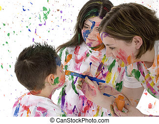 Family Fun - Big sisters painting little brother\\\'s face....