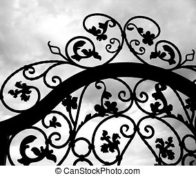 Wrought Iron Gate - -- seen against a dramatic sky