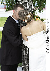 bride and groom kissing - tender wedding kiss