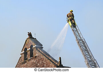 Firefighter extinguishes fire - fireman puts out fire