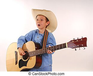 Lonesome Cowboy - Young boy playing guitar