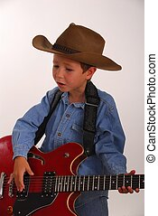 Lonesome Cowboy 11 - Young boy playing guitar