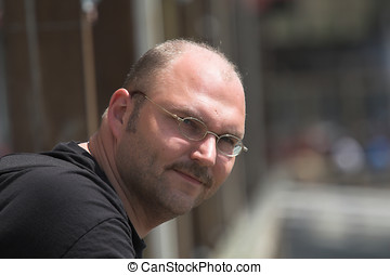 Handsome man on a sunny day - Handsome balding man on a...
