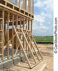 New Home Framing - New home framing with leaning unfinished...