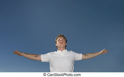 Young man raises his arm in flight and victory