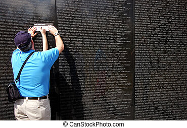 Vietnam war memorial - Copying down the name of a fallen...