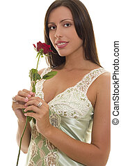 Young woman with Red Rose - A woman holding a long stemmed...