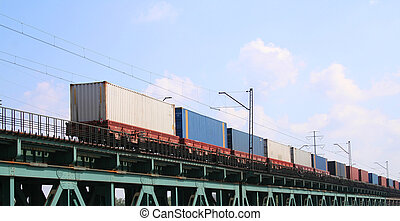 Cargo train crossing the bridge