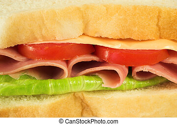 Food #28 - A ham, cheese, tomato and lettuce sandwich on a...