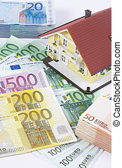 house with banknotes - banknotes with house